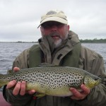 Dad with a superbly marked and conditioned fish of about 5lbs. It nailed a wet mayfly and took off like a train!