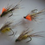 Size 10 Kamasan 175, Red rib, deer hair and/or red game tail, mayfly colured body, Deer hair wing, high viz or white post.