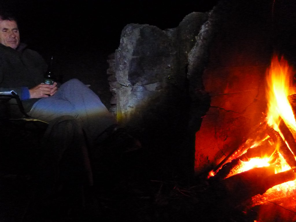 We camped out. The rain didn't dampen our spirits one bit. We just burned more wood! Here is Robbie in his happy place!