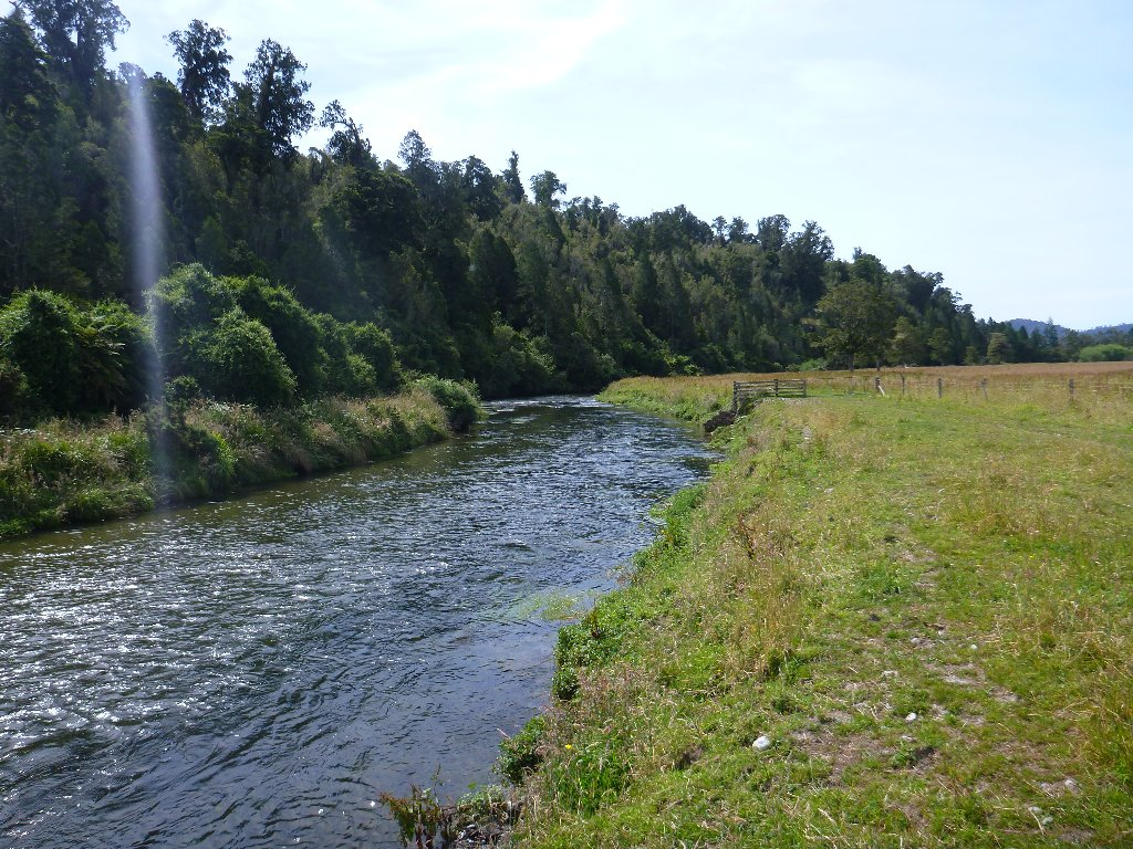 This lovely river flowed along the edge of farm and forest.