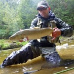 A great fish! Happy to have waders on this freezing summers day with the river rising fast!