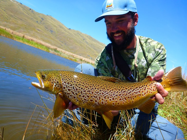 The climb was worth it for Jeff.. In an anglers lifetime, he's not likely to catch many trout as truly stunning as this.