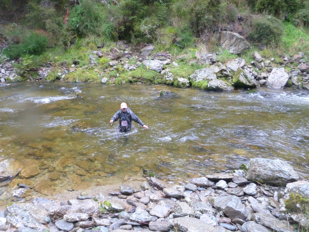 Wet and cold or not, we were there to fish. We climbed down the steep incline to the river. Thankfully it had not yet coloured much.
