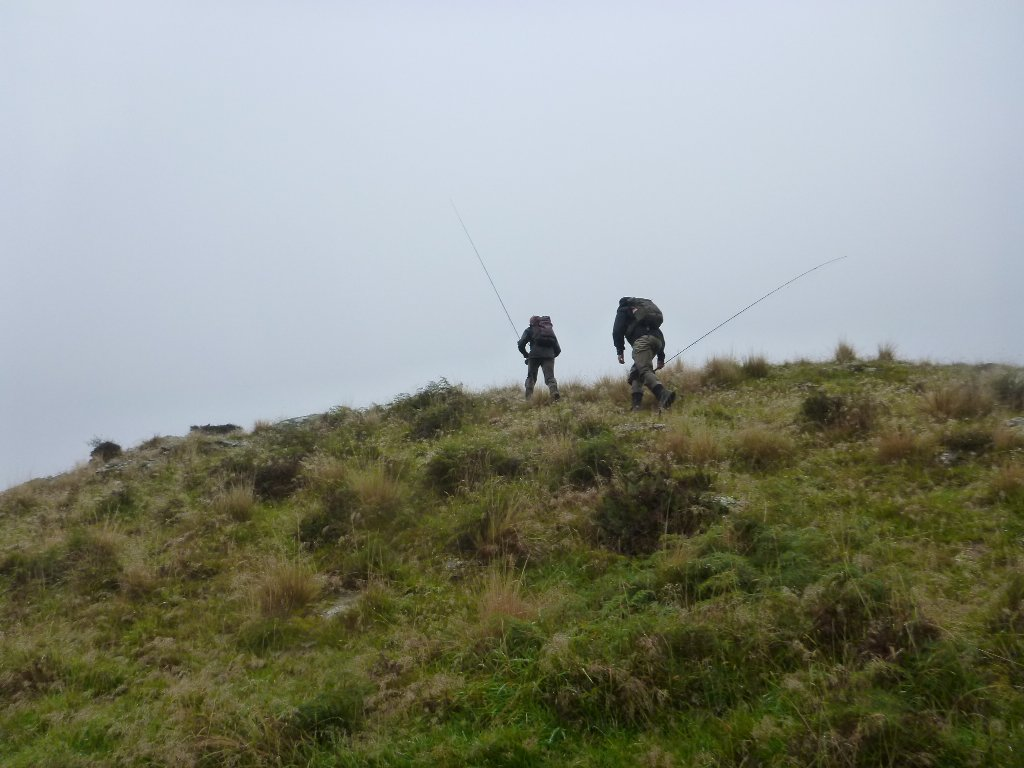 As the rain came in we climbed out of the gorge to skip a bluff..