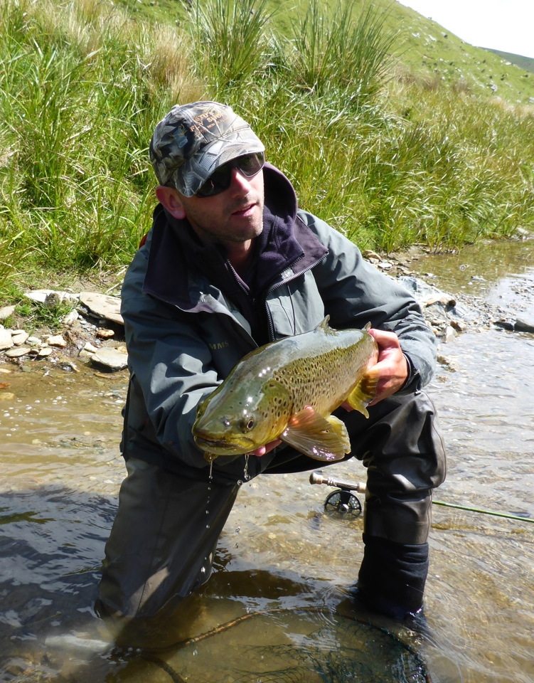 A quick pose for Bob's camera before releasing this big trout..