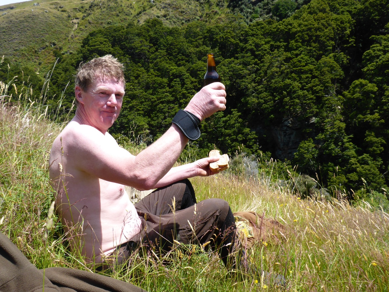 Con drying out on the top of the gorge after his tumble into the river.. A good time for lunch!
