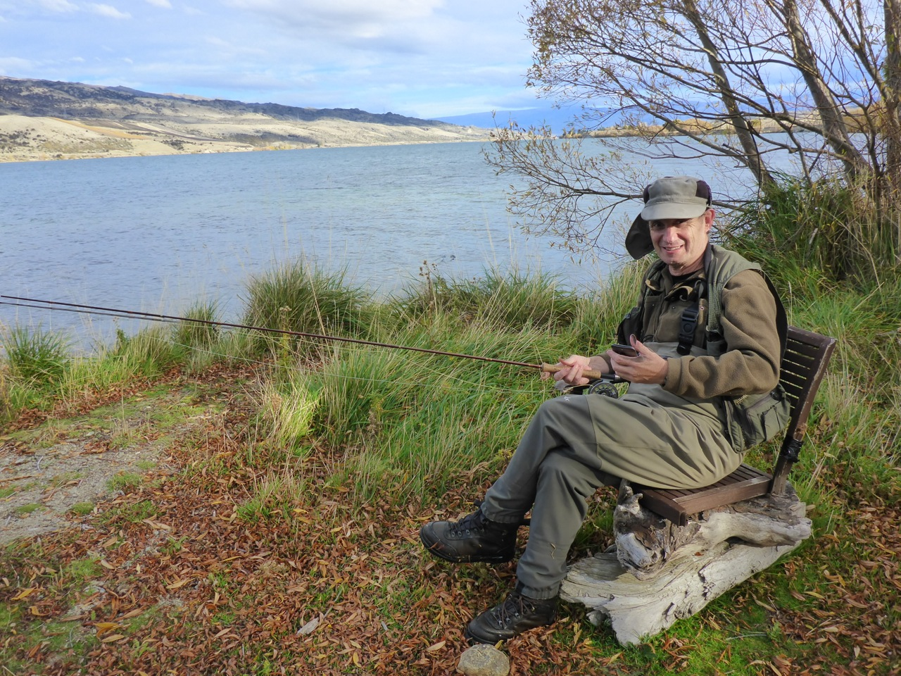 Camo-Guy relaxing on an abandoned chair on Lake Dunstan.