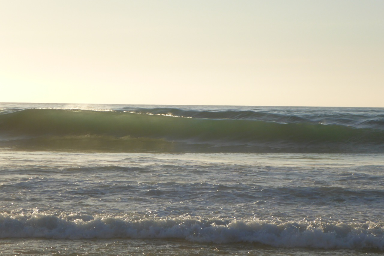 The surf rolls in..