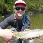 Day trip ex Queenstown. Total beginner, Peter with a nice trout! Well played from cast to net!!