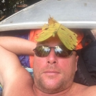 Paul with a leaf on his head. It's important to make use of all local materials when camping in the jungle.