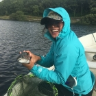 Ashly catches a trout at Val de Mar on a dry!
