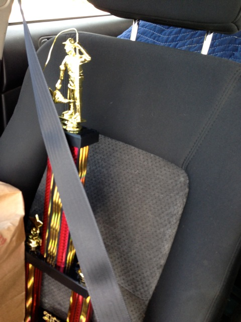 trophy in car passenger seat